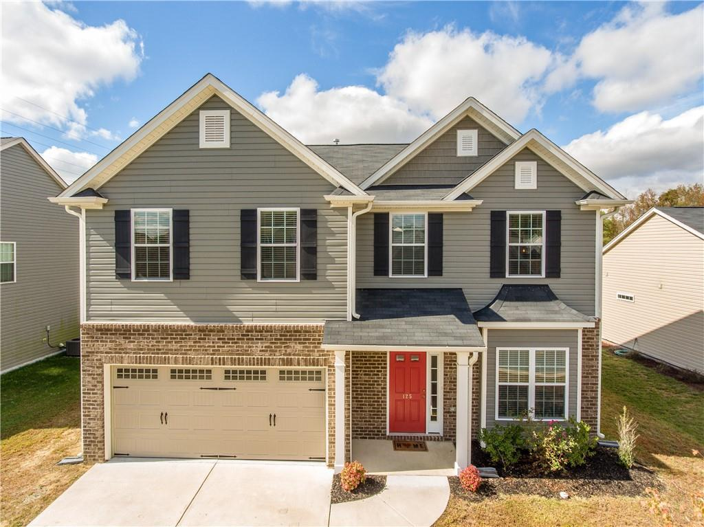 Photo of home for sale at 125 Claystone Drive, Gibsonville NC