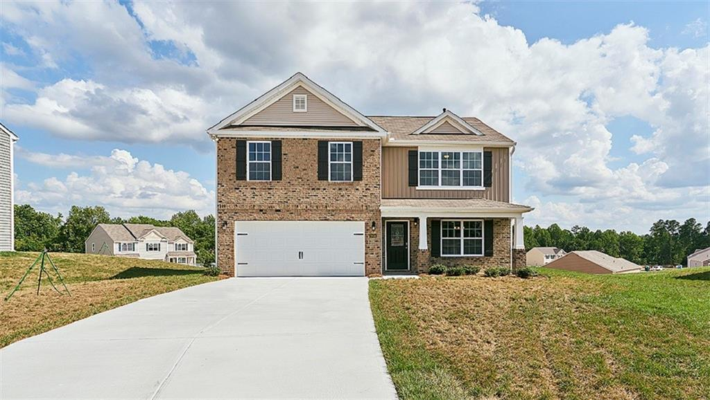Photo of home for sale at 677 Affirmed Drive, Whitsett NC
