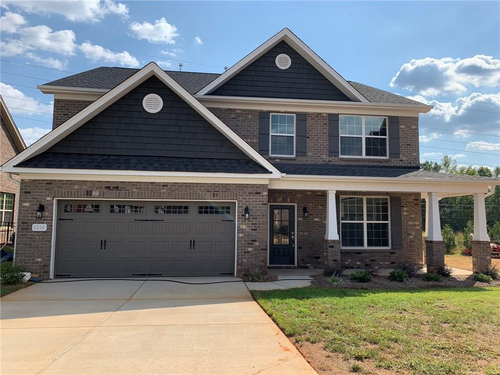 Photo of home for sale at 1316 Stone Gables Drive, Elon NC