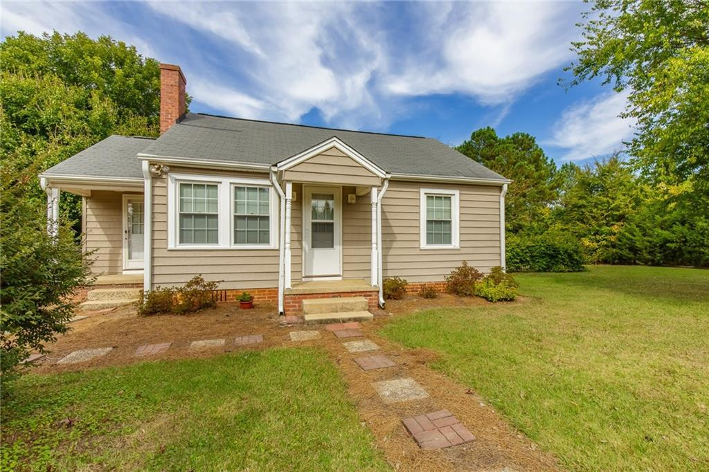 Photo of home for sale at 128 Moore Street E, Graham NC