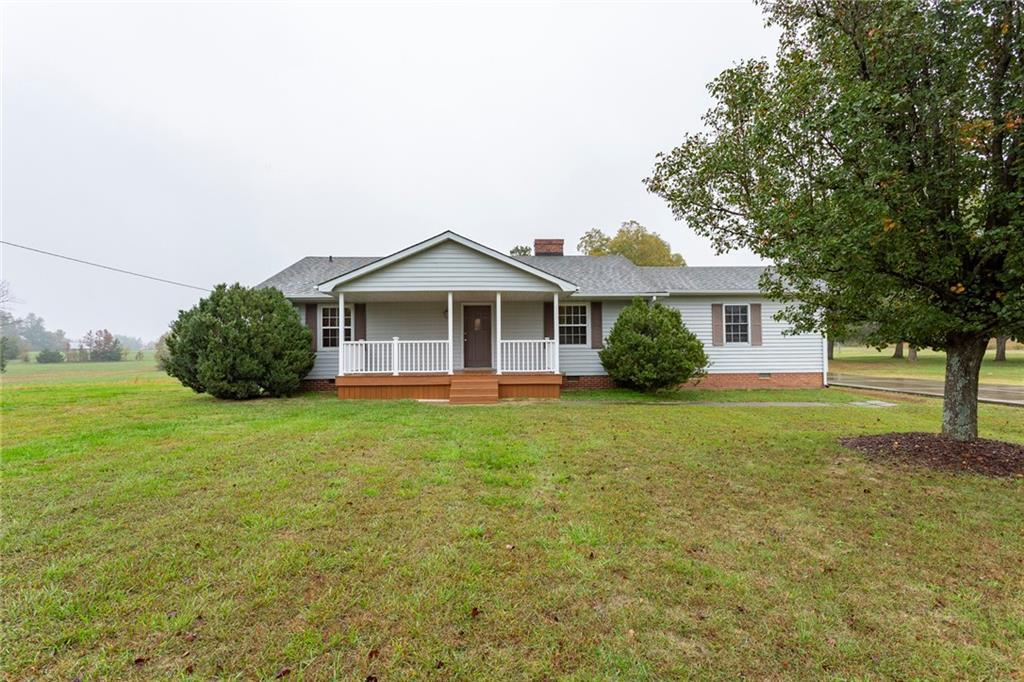 Photo of home for sale at 3209 Greensboro Chapel Hill Rd W, Liberty NC