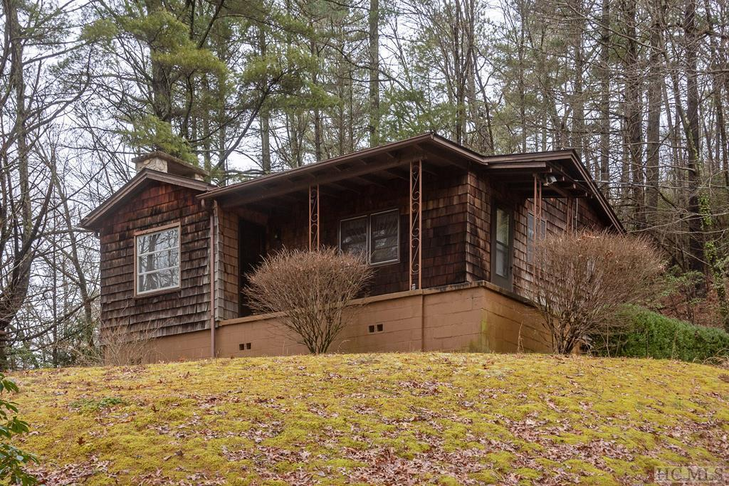 Photo of home for sale at 6593 Hwy 107S, Cashiers NC
