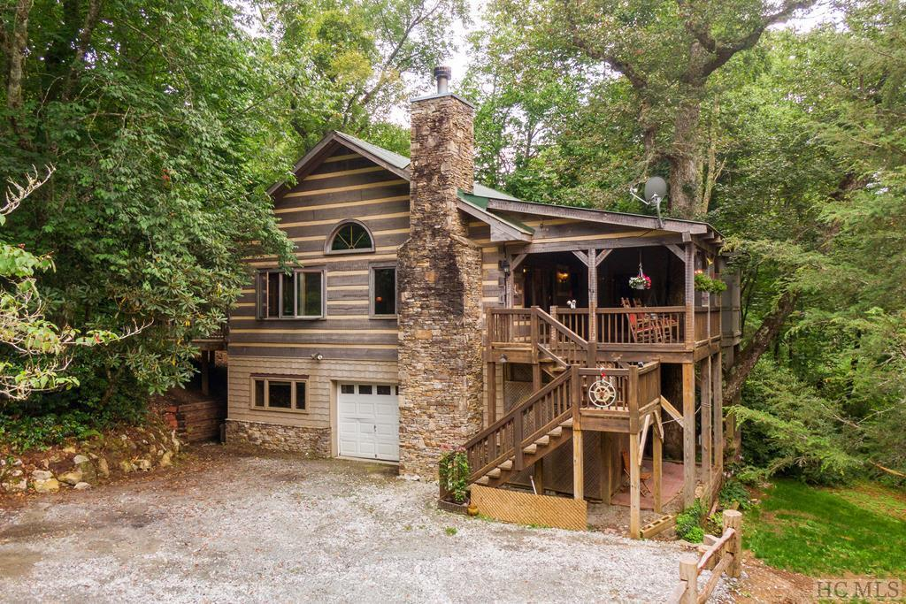 Photo of home for sale at 192 Tall Cedars, Glenville NC