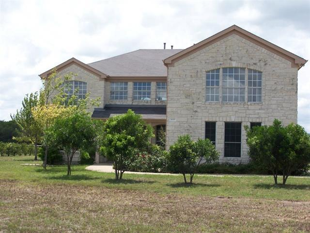 Photo of home for sale at 1620 Red Bud LN, Round Rock TX