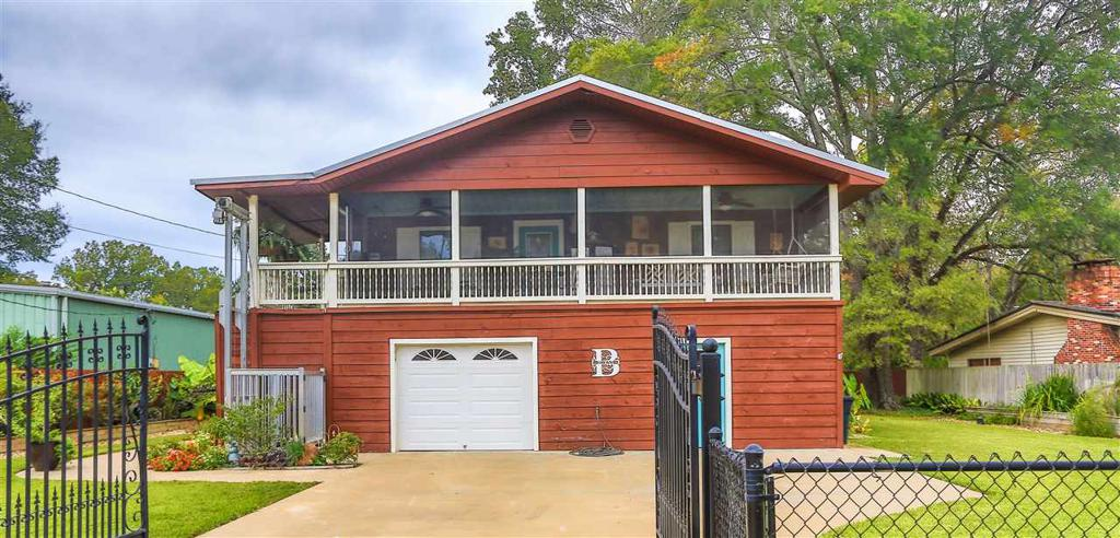 Photo of home for sale at 213 Cypress Dr, Karnack TX