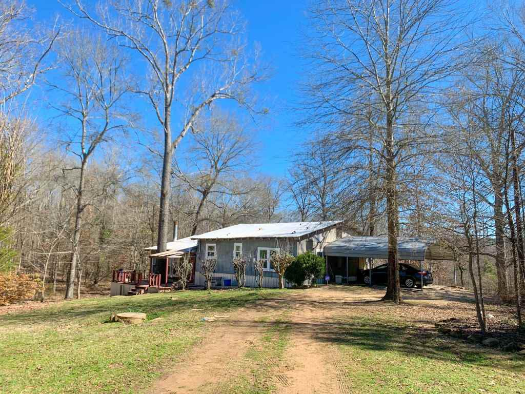 Photo of home for sale at 450 Doyle Rd, Avinger TX