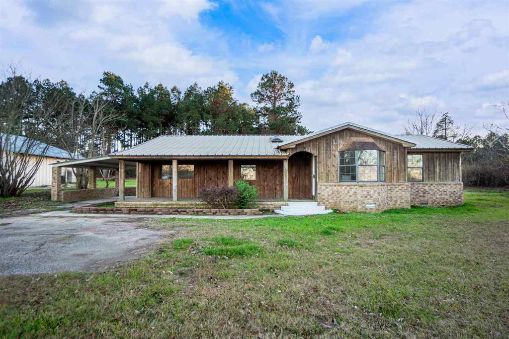 Photo of home for sale at 1447 Tom Smith Rd, Harleton TX