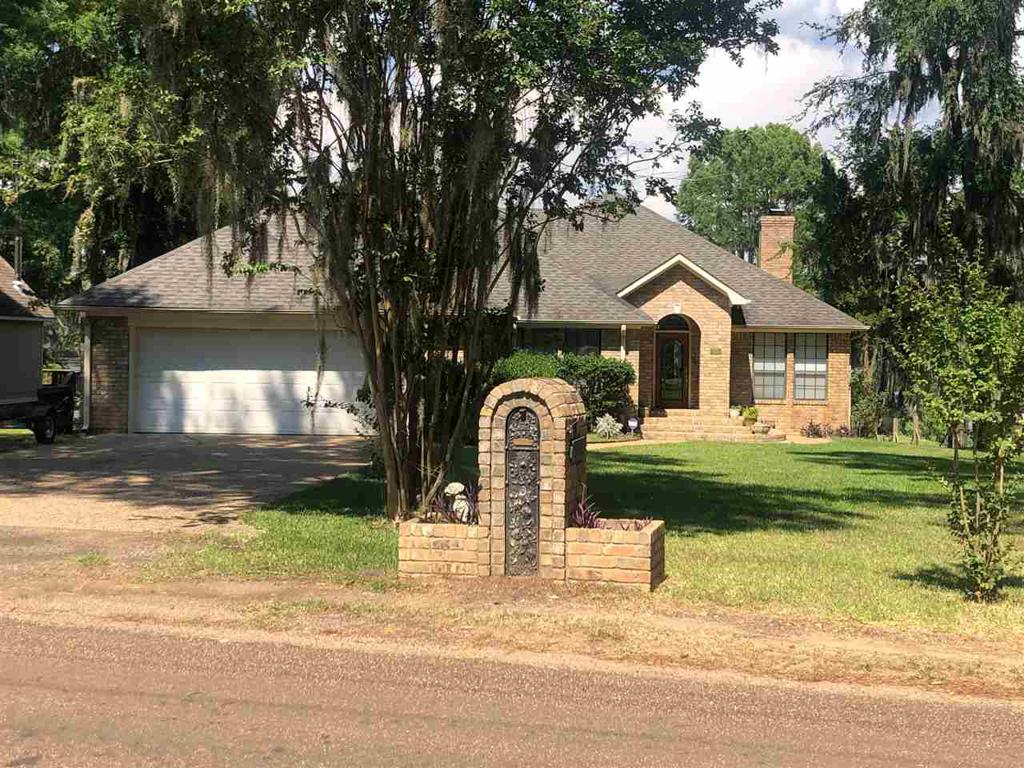 Photo of home for sale at 586 Cypress Dr, Karnack TX