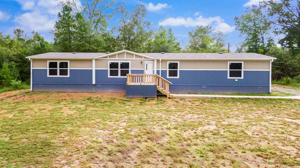Photo of home for sale at 1241 Sam Hall Rd., Hallsville TX