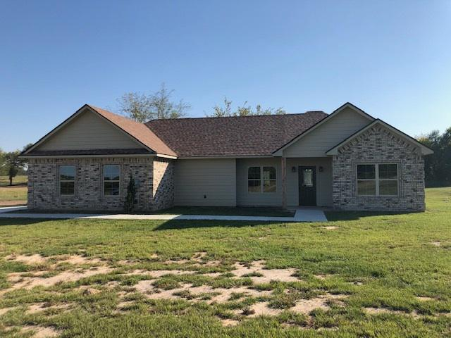 Photo of home for sale at 6913 State Hwy 154 W, Gilmer TX
