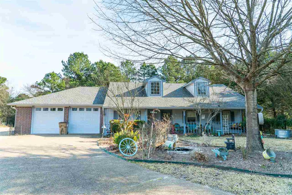 Photo of home for sale at 154 Ox Cart, Holly Lake Ranch TX